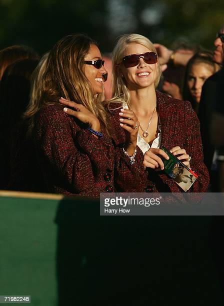 Melissa Lehman and Elin Woods share a joke during the closing ceremony after Europe win the Ryder Cup by a score of 18 1/2 9 1/2 on the final day of...