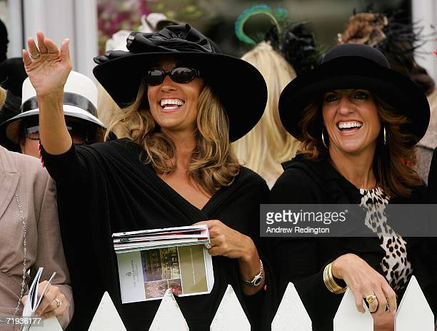 Melissa Lehman wife of Tom Lehman and Amy DiMarco wife of Chris DiMarco smile during the Ryder Cup Wives Race Day at The Curragh racecourse on...