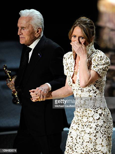 Melissa Leo is presented an award onstage by Kirk Douglas during the 83rd Annual Academy Awards held at the Kodak Theatre on February 27 2011 in...