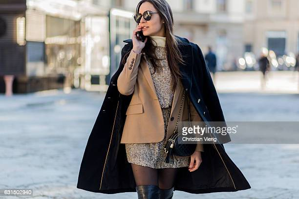 Melissa Longobardi is wearing a dress Dior bag boots wool coat on January 11 2017 in Florence Italy