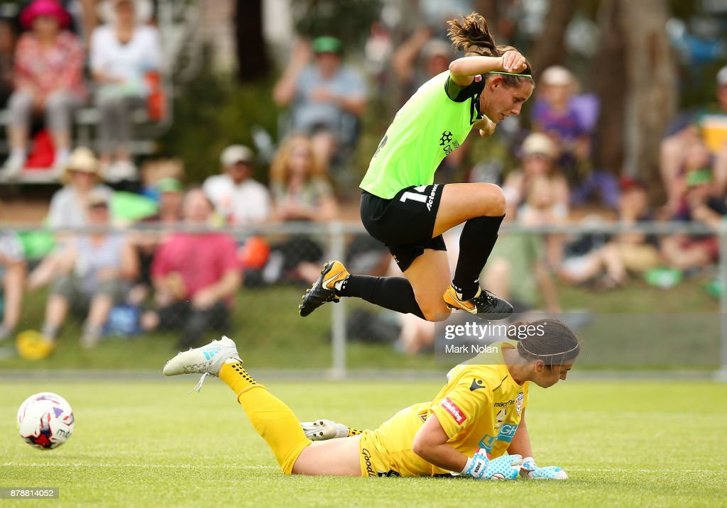 Melissa Maizels of Perth makes a save on an attacking raid by Ashleigh Sykes of Canberra during the round five W-League match between Canberra United and Perth Glory at McKellar Park on November 25, 2017 in Canberra, Australia.