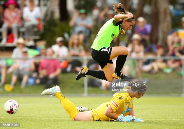Melissa Maizels of Perth makes a save on an attacking raid by Ashleigh Sykes of Canberra during the round five W-League match between Canberra United...