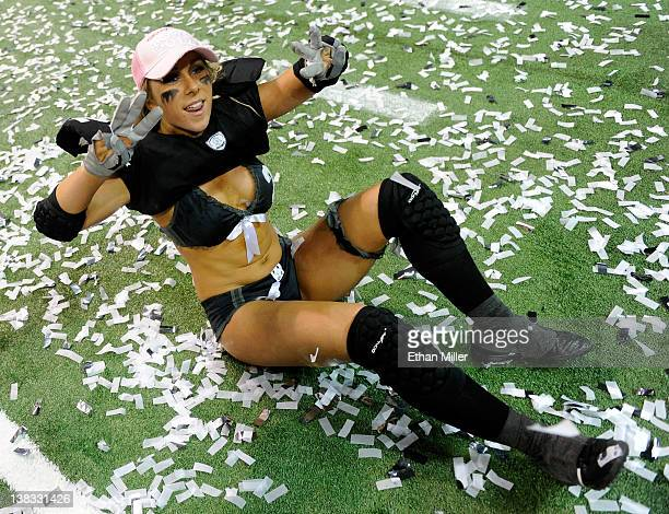 Melissa Margulies of the Los Angeles Temptation holds up three fingers on each hand as she celebrates her team's 28-6 victory over the Philadelphia...