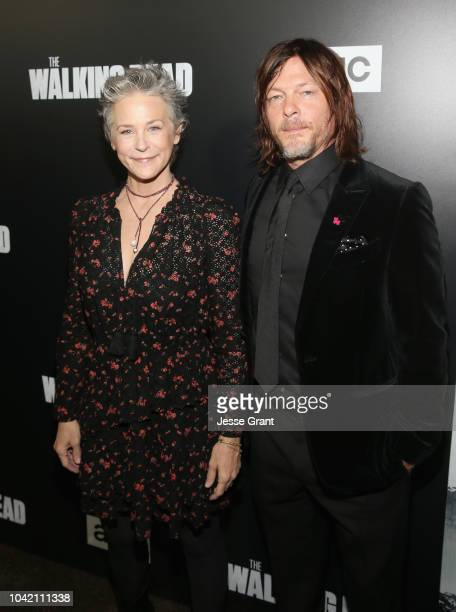 Melissa McBride and Norman Reedus attend The Walking Dead Premiere and After Party on September 27 2018 in Los Angeles California