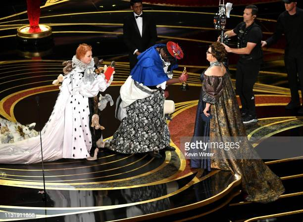 Melissa McCarthy and Brian Tyree Henry present the Costume Design award for 'Black Panther' to Ruth E Carter onstage during the 91st Annual Academy...