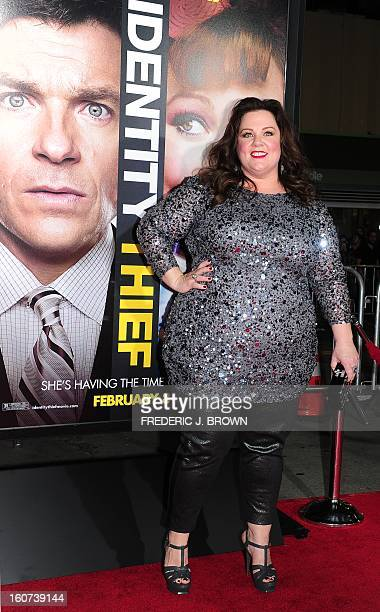 Melissa McCarthy poses on arrival for the World Premiere of the film 'Identity Thief' in Los Angeles, California, on February 4, 2013. The films...
