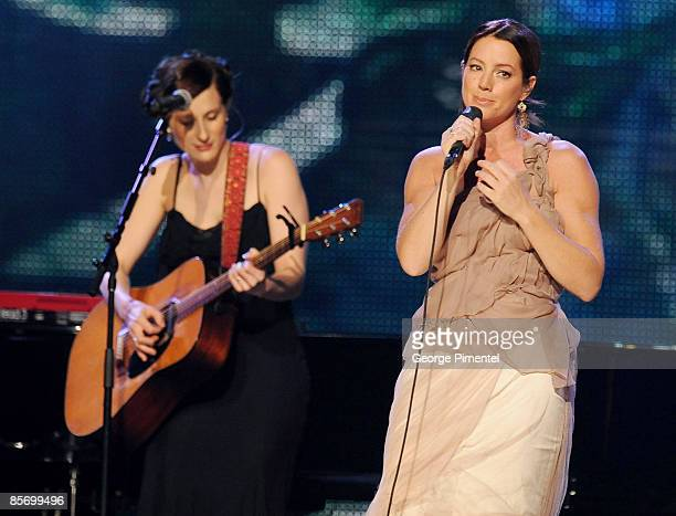 Melissa McClelland and Sarah McLachlan perform on stage during the 2009 Juno Awards at General Motors Place on March 29 2009 in Vancouver Canada