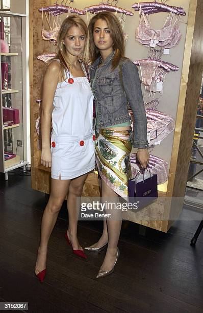 Melissa Montgomery and friend attend the Frost French Perrier Jouet Lingerie Launch at Liberty on June 25 2003 in London