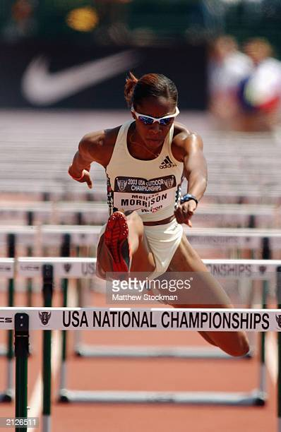 Melissa Morrison competes in the preliminary heats of the women's 100m hurdles at the USA Outdoor Track and Field Championships on June 22, 2003 at...