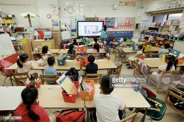 Melissa Moy, a teacher at Yung Wing School P.S. 124, goes over a lesson on a monitor with in-person Summer program students on July 22, 2021 in New...