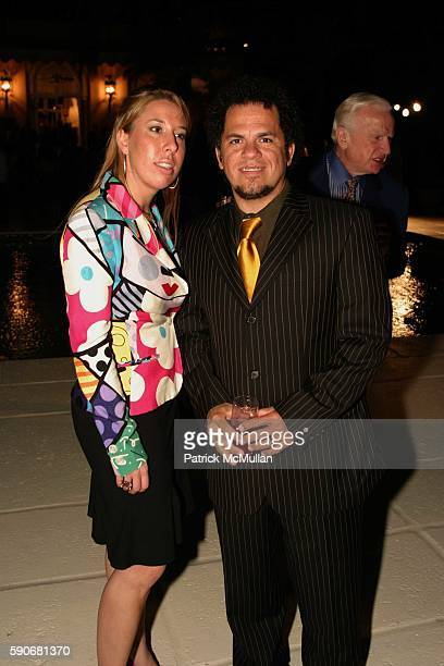 Melissa Murphy and Romero Britto attend Russell Simmons' Art For Life Palm Beach To Honor SeanPDIDDY Combs Hosted by Donald and Melania Trump at The...