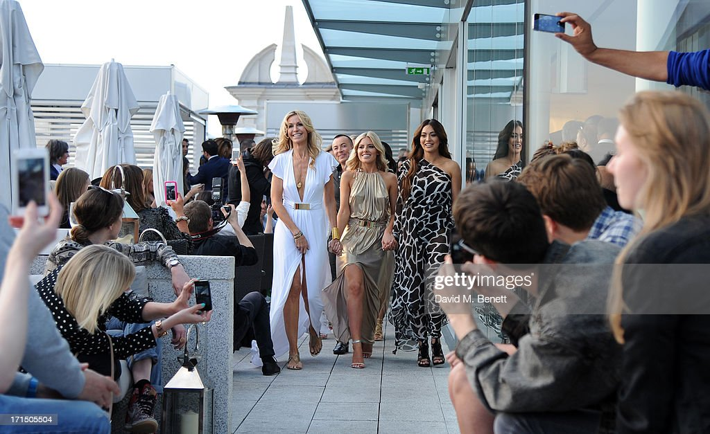 Melissa Odabash, Mollie King and Zara Martin on the runway at the Odabash Macdonald Resort 2014 collection launch at ME Hotel on June 25, 2013 in London, England.