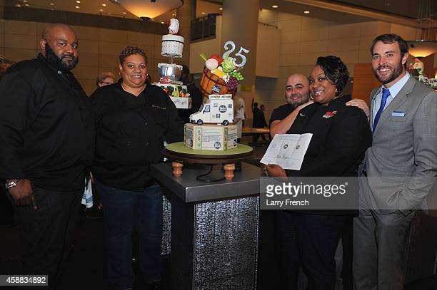 Melissa Payne of Couture Cake Creations is congratulated by host Duff Goldman and reporter Scott Thuman of WJLA as she wins the High Stake Cakes...