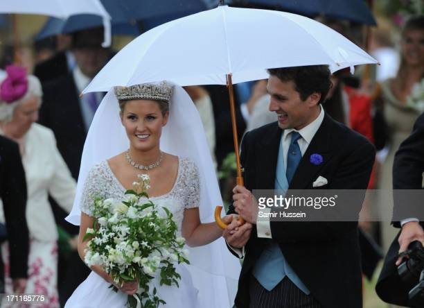 Melissa Percy and Thomas Staubenzee leave Alnwick Castle following their marriage on June 22 2013 in Alnwick England