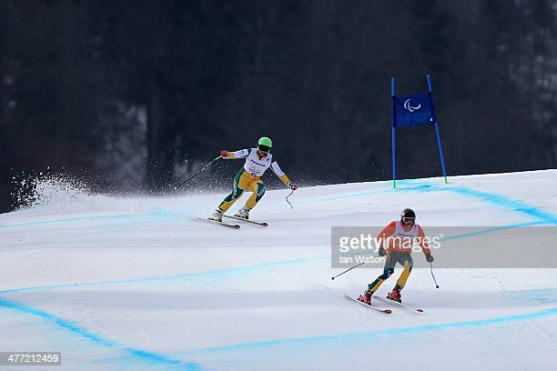 Melissa Perrine of Australia and her guide Andrew Bor compete in the Women's Downhill Visually Impaired during day one of Sochi 2014 Paralympic...