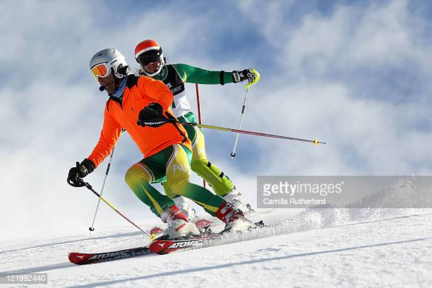Melissa Perrine of Australia is guided by Andrew Bor in the Womens Slalom Visually Impaired during day 13 of the Winter Games NZ at Coronet Peak on...
