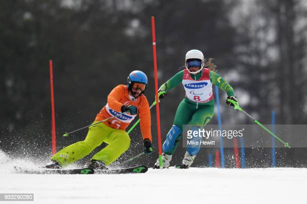 Melissa Perrine of Australia on her way to 4th place with her guide Christian Geiger in the Women's Slalom Visually Impaired on day nine of the...