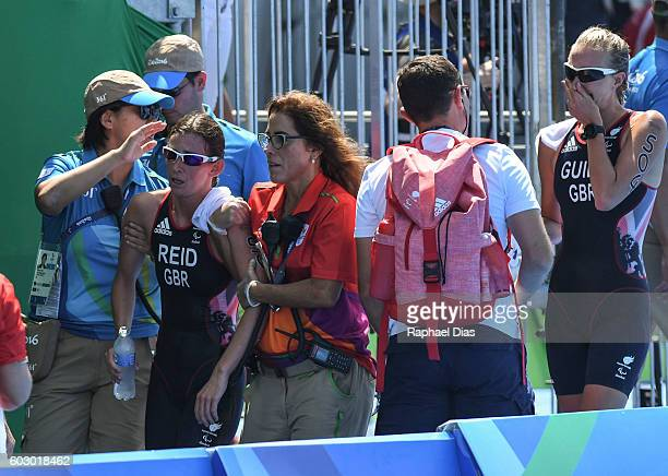 Melissa Reid from Great Britain being helped after finishing third place at the Triathlon Women's PT5 at Forte de Copacabana on day 4 of the Rio 2016...