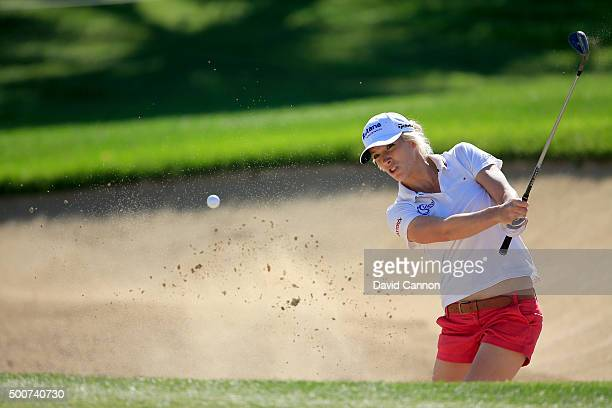 Melissa Reid of England plays her third shot on the par 4 eighth hole during the second round of the 2015 Omega Dubai Ladies Masters on the Majlis...
