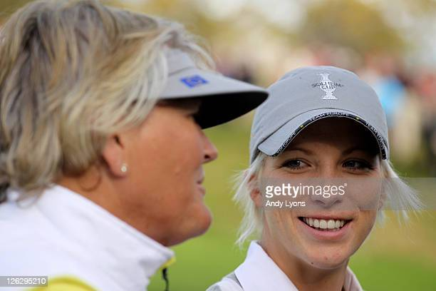 Melissa Reid of Europe and Laura Davies chat during the afternoon fourballs on day two of the 2011 Solheim Cup at Killeen Castle Golf Club on...