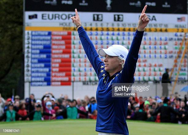 Melissa Reid of Europe celebrates her team's 1513 victory on the 18th green during the singles matches on day three of the 2011 Solheim Cup at...