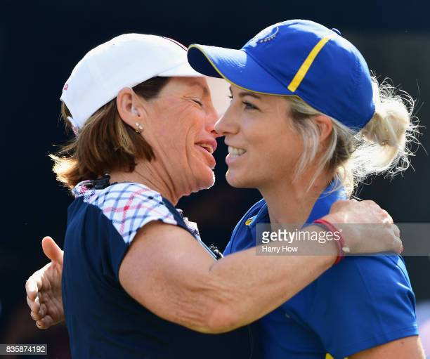 Melissa Reid of Team Europe receives a hug from Captain Juli Inkster of the United States on the first tee during the final day singles matches of...