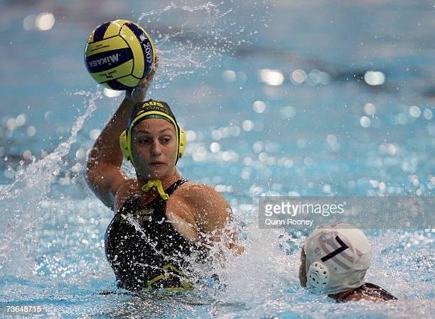 Melissa Rippon of Australia prepares to shoot past Angelica Marie Garcia of Puerto Rico in the Women's Preliminary Round Group B Water Polo match...