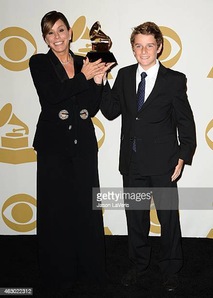 Melissa Rivers and and son Cooper Endicott accept Best Spoken Word Album for 'Diary Of A Mad Diva' on behalf of Joan Rivers pose in the press room at...