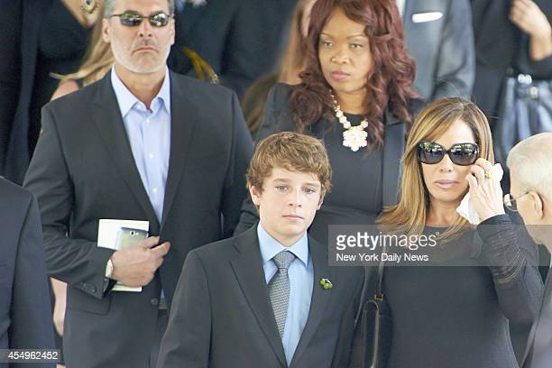 Melissa Rivers daughter of comedienne Joan Rivers right and Cooper Endicott grandson of Rivers leaves after a funeral service for Rivers at Temple...