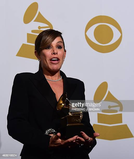 Melissa Rivers daughter of the late comedian Joan Rivers holds the Grammy Award for her mother's spoken word album Diary of a Mad Diva in the press...