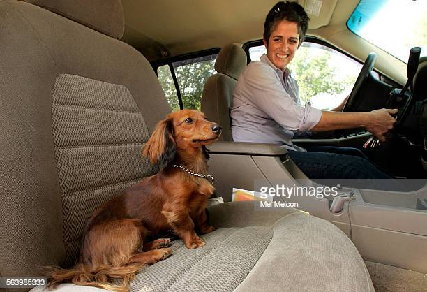 Melissa Roth a pet concierge and Olive a 1 year old dachshund in the passenger seat of her 2003 Ford Explorer prepare to head out to the Silverlake...