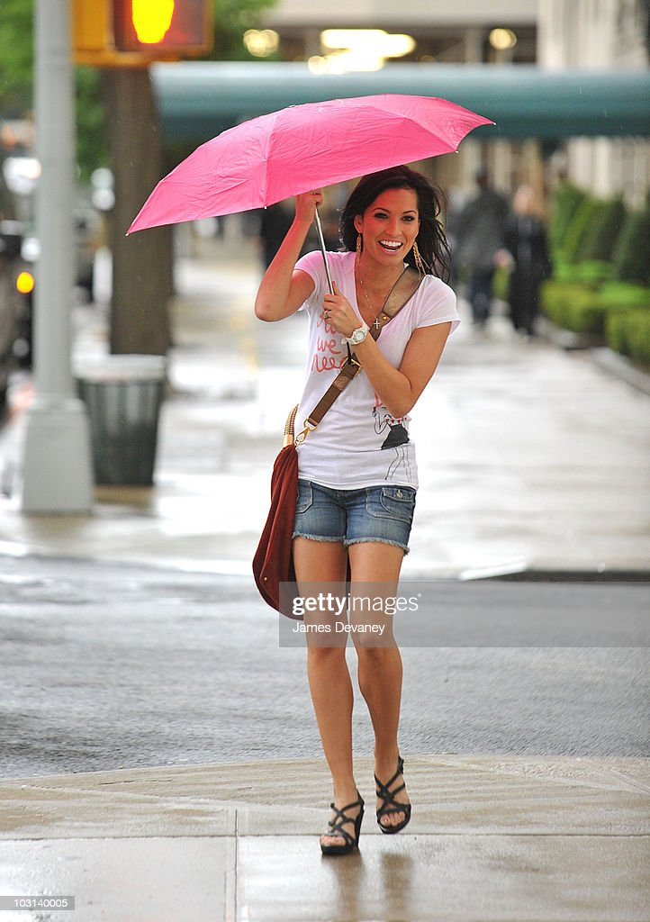 Melissa Rycroft gets caught in the rain in her Rockport sandals on 5th Ave on April 22, 2010 in New York City.