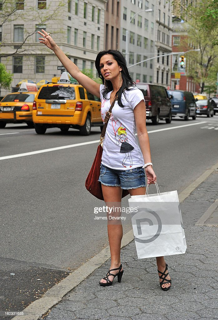 Melissa Rycroft hails a taxi on 5th Ave in her Rockport sandals on April 22, 2010 in New York City.