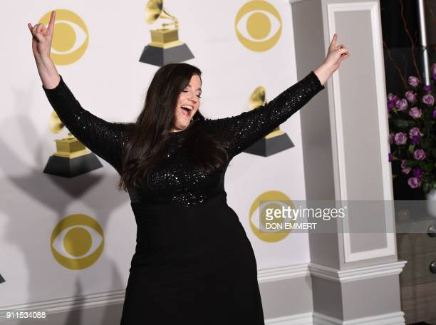 Melissa Salguero recipient of the 2018 Music Educator Award poses in the press room during the 60th Annual Grammy Awards on January 28 in New York /...