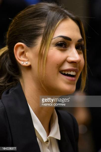 Melissa Satta the girlfriend of AC Milan's Ghana international KevinPrince Boateng smiles during a panel discussion on racism and sport on March 21...