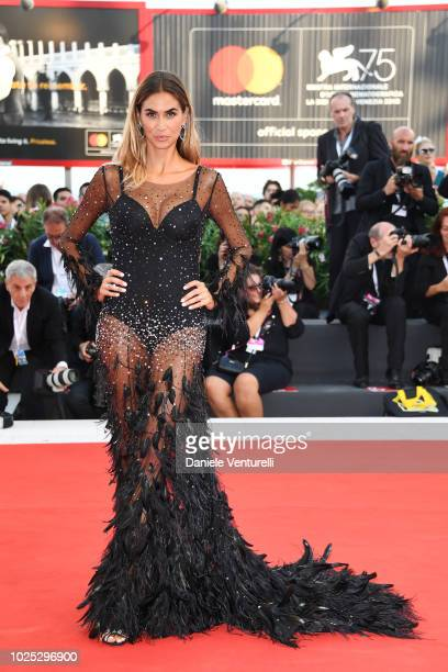 Melissa Satta walks the red carpet ahead of the 'Roma' screening during the 75th Venice Film Festival at Sala Grande on August 30 2018 in Venice Italy