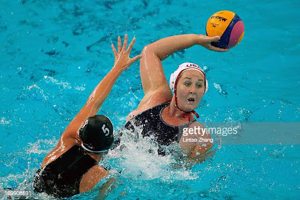 Melissa Seidemann of the United States challenges Monika Eggens of Canada during day fourth of the FINA Women's World League Super Final 2013 match...