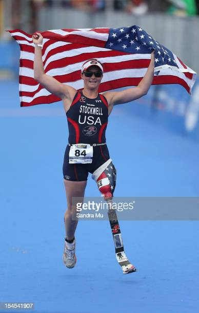 Melissa Stockwell of USA celebrates as she runs down the finishing shoot to win the Paratriathlon Female Tri-2 race on October 22, 2012 in Auckland,...