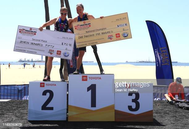 Melissa Stockwell second place and Hailey Danisewicz first place stand on the podium for the Female PTS2 division of the Legacy Triathlon-USA...