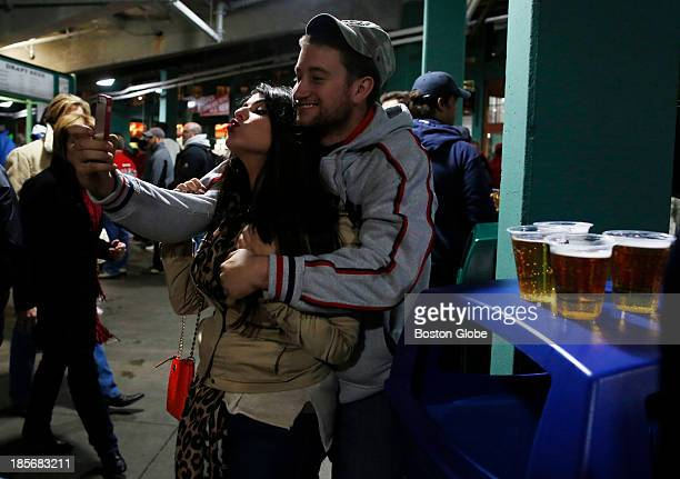 Melissa Stopford and John Cresta both of Revere pose for a self portrait during Game One of the 2013 Major League Baseball World Series between the...