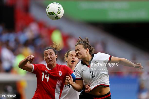Melissa Tancredi of Canada and Josephine Henning of Germany head the ball during the Women's First Round Group F match between Germany and Canada on...