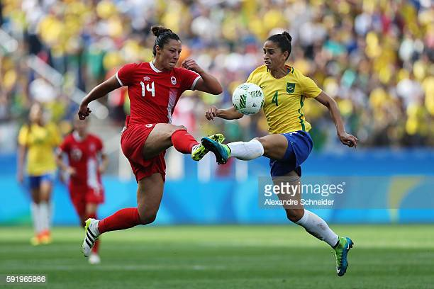 Melissa Tancredi of Canada and Rafaelle of Brazil challenge for the ball during the Women's Olympic Football Bronze Medal match between Brazil and...