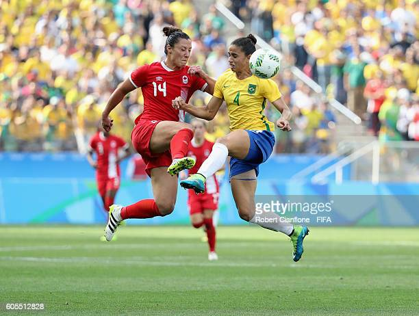 Melissa Tancredi of Canada and Rafaelle of Brazil compete for the ball during the Women's Football Bronze Medal match between Brazil and Canada on...