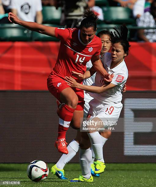 Melissa Tancredi of Canada beats the challenge from Ruyin Tan of China PR during the FIFA Women's World Cup 2015 Group A match between Canada and...