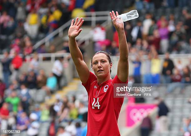 Melissa Tancredi of Canada waves to the crowd after Canada and Sweden drew at the Women's Football first round Group F Match between Canada and...