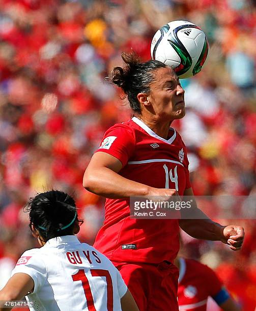 Melissa Tancredi of Canada wins a header against Gu Yasha of China during the FIFA Women's World Cup Canada 2015 Group A match between Canada and...
