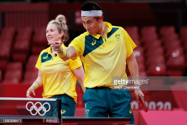 Melissa Tapper and Hu Heming of Team Australia react during their Mixed Doubles Round of 16 on day one of the Tokyo 2020 Olympic Games at Tokyo...