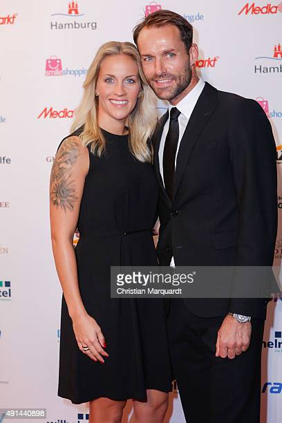 Melissa Thiem and Sven Hannawald attend the Deutscher Sportjournalistenpreis 2015 at Grand Elysee Hotel on October 5 2015 in Hamburg Germany