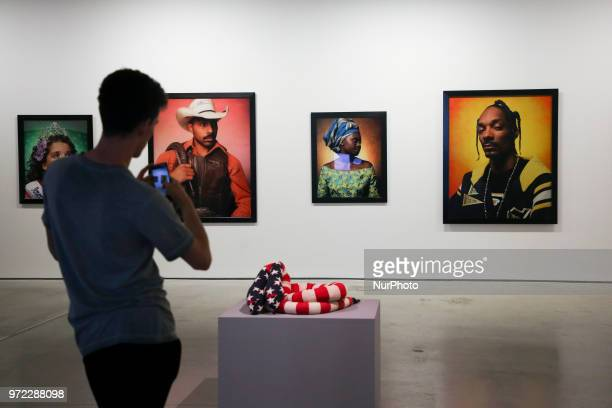 Melissa Vandenberg's 'polycephanic Patriot' 2012 and Andres Serrano's 20022004 photograps at 'Motherland in Art' exhibition in MOCAK The Museum of...