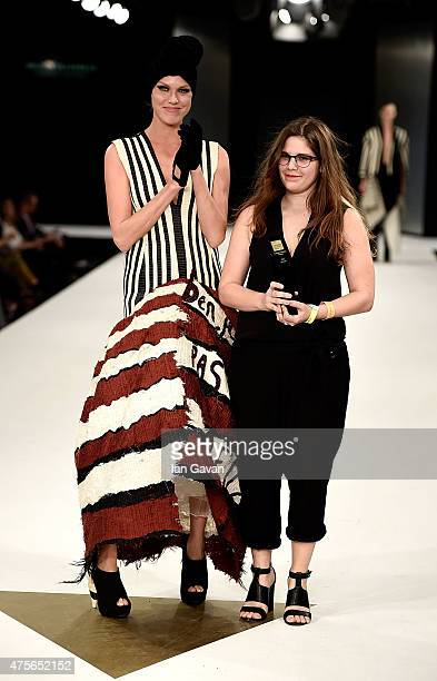 Melissa Villevieille accepts an award at the Graduate Fashion Week George Gold Award show at The Old Truman Brewery on June 2 2015 in London England